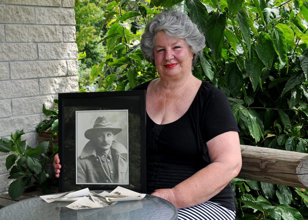 Virginia Dysart, with photographs of her father, Trooper Pynson Mossman (Image: Jan Sutherland)
