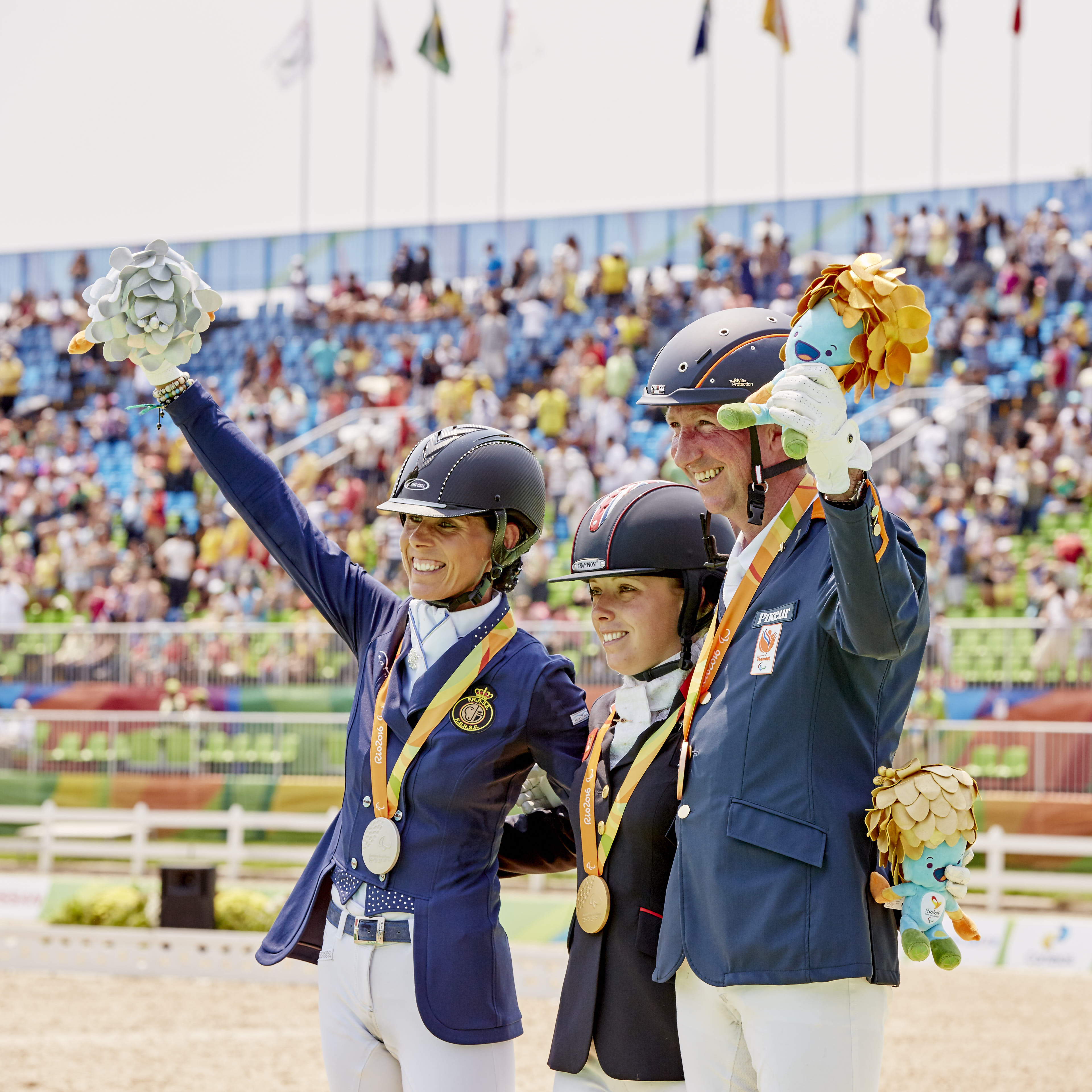 Grade IV Podium finish, Sophie Wells (Gold, UK), Belgium's Michèle George (silver), and The Netherlands' Frank Hosmar (bronze) (Image: FEI/Liz Gregg)